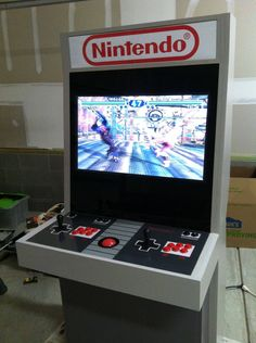 An Amazingly Accurate DIY Nintendo Controller Themed Arcade Cabinet Gaming Cabinet, Diy Arcade Cabinet, Pac Man, Mame Cabinet, Bartop Arcade, Nintendo Controller, Arcade Machine, Retro Video Games, Minions