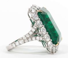 Rare Twenty-Six Carat Green Emerald and Diamond Ring   From a unique collection of vintage cocktail rings at https://www.1stdibs.com/jewelry/rings/cocktail-rings/