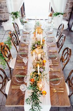 Decorated with gold and greenery, this rustic vineyard wedding will inspire your summer celebration. Plus, copper lanterns and plenty of candles help give your reception the romantic and cozy feeling you've been dreaming of. #weddingcandlesdecorations #weddingcandlesdesign