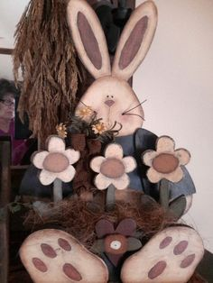 Rustic Bunny with flowers. Cute to sit on a porch. Welcome Bunny