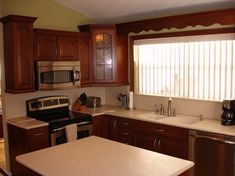 Timberlake Cherry Kitchen with Corian Sahara Countertops « Beverin Solid Surface, Inc.