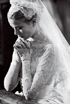 Brides.com: 16 Unforgettable Photos from Vogue Weddings. Grace Kelly, in a gown by MGM costume designer Helen Rose, kneeling at the altar during her wedding at Saint Nicholas Cathedral to Prince Rainier III of Monaco in April 1956.
