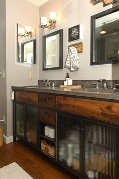 Concrete vanity top. Lacquered steel base with reclaimed barnwood and reeded glass.