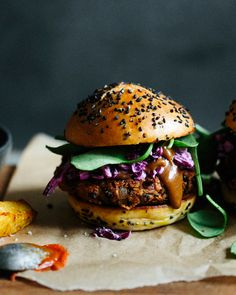 A smoky black bean burger with plum rum sauce and red cabbage slaw.