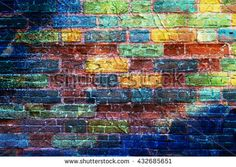 Bright colorful multicolored painted brick stone wall. - stock photo