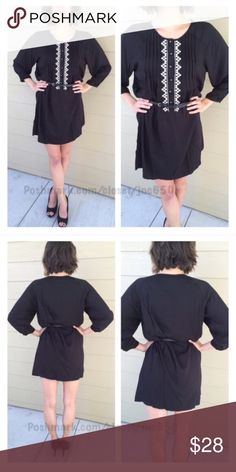 """Black/ white dress Black dress S- L: 34"""" B: 38"""" M- L: 36"""" B: 40"""" Materials- 65% cotton/ 35% polyester. This dress has no stretch to it. The front has a button closure. Belt included! Model is a S/4 and wearing a size S. Availability- S•M • 1•2 ⭐️This item is brand new with manufacturers tags, boutique tags, or in original packaging. 🚫NO TRADES 💲Fair offers will be accepted 💰Ask about bundle discounts Dresses Long Sleeve"""