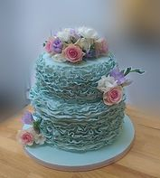 The Cake Lab Ranelagh, Dublin, Ireland. Artisan Baking Studio.  Green fondant ruffle cake with fresh flowers.