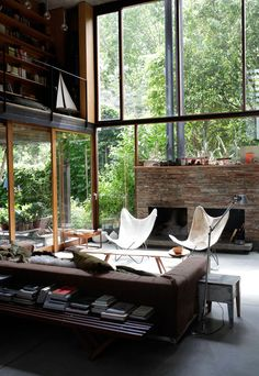 Windows, fireplace, butterfly chairs