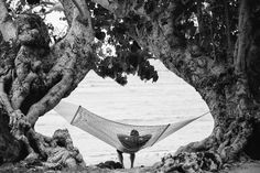 The spectacular and handiwork of nature relaxing on a hammock, only at The Remote Resort, Fiji Islands.