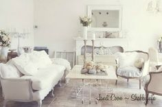 Janet's by Shabbyfufu french style living room. I adore old metal work pieces!