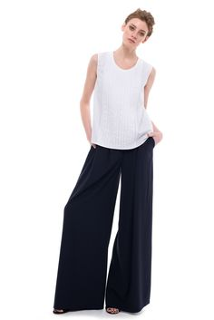 These black palazzo pants are pleated to create a flattering wide-leg silhouette. Black Palazzo Pants, Palazzo Trousers, Crochet Collar, Cotton Skirt, Shades Of Blue, Silk Dress, Wide Leg, Pajama Pants, Jumpsuit
