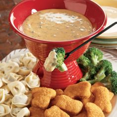 """October Dinner Fondue"" from Campbell's Kitchen to serve with chicken, veggies or tortellini. Uses cream of chicken soup and cheddar cheese as the main ingredients."
