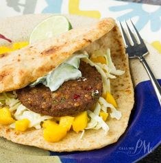 Full of crunch from curry slaw, sweetness from mango and a coo yogurt sauce you'll love the flavors and textures of Spicy Indian Naan Wrap @pmctunejones