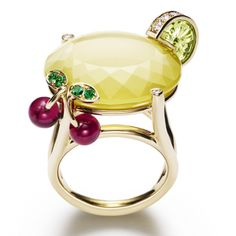 Lemon Fizz by Piaget - the drink is a large faceted yellow quartz garnished with a slice of lemon in peridot and diamond and a pair of rubilite and emerald cherries set in 18k yellow gold.
