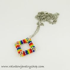 Woven with glass beads, pendant hangs on a 20 inch chain, which can be adjusted to suit.