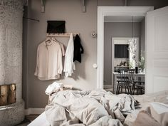 Home Tour into a Soft Greige Scandinavian Apartment Small Apartment Interior, Scandinavian Apartment, Scandinavian Home, Messy Bed, Swedish Interiors, Warm Colour Palette, Rustic Bedding, Modern Bedding, Simple Bed