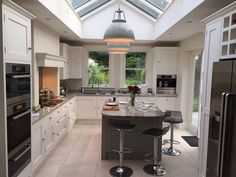 kitchen with roof lantern and shaker style units