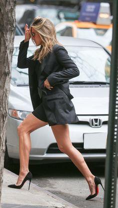 Jennifer A. strutting in pump[s