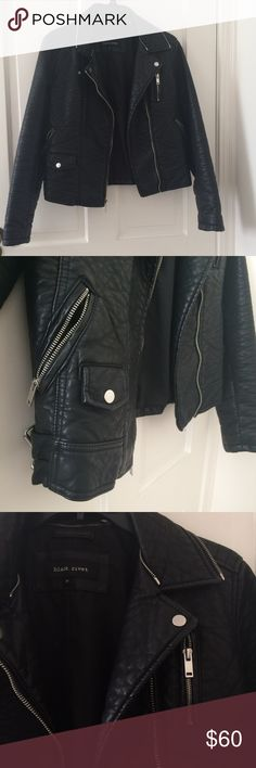 Faux leather moto biker jacket This faux leather biker jacket will make you feel like a b*dass when wearing it. Has many zipper details throughout the jacket and belts on the sides. Worn only a few times so it's in good condition still. Side medium women's. Jackets & Coats