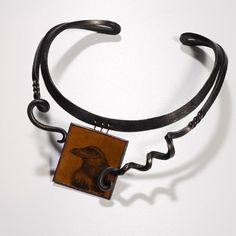 """Jaclyn Davidson, 'Poe's Crow' Neckpiece in carbon steel, 18k gold, enamel on copper, and sterling silver. 17"""" inner circumference."""