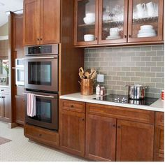 Wood cabinets, white counter