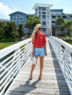Brown chunky strap heels, Blue sail print shorts, Red &White polka-dot blouse, White clutch, Black sunnies