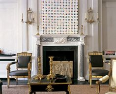 A House in London - Designer Frederic Mechiche - Classical Adam Mantlepiece contrasting with Modern Art Painting.