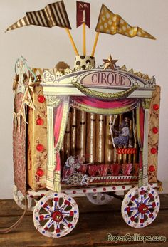 Altered art circus paper calliope with four scenes by artist Betsy Skagen | http://www.papercalliope.com  #circus #vintagecircus #alphastamps