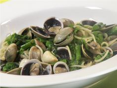 Spaghetti with Broccoli Rabe and Vongole http://www.cookingwithnonna.com/italian-cuisine/spaghetti-with-broccoli-rabe-and-vongole.html