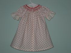 This is the back of the dress.  There is a little red heart button to accent the tiny red hearts in the fabric and the heart-shaped smocking.