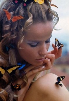 Veruschka surrounded by butterflies with makeup by Shiseido, Brazil, January 1968.