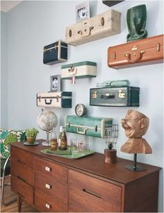 suitcases as shelves...this would be fun with travel pictures and souvenirs