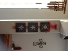 Took A'na's crocheted snowflakes and put in frames, added red ribbon.
