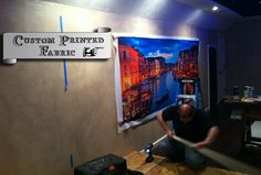 Printed acoustic fabric panel over acoustic board before the finishing touches.