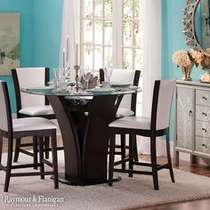 """Want to add a touch of glitz and glamour to your dining room next year? Pull in inspiration from """"Breakfast at Tiffany's"""" with Tiffany's trademark blue on your walls. Then accentuate with wall art and other décor!"""