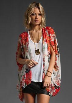 Winter Kate kimono + leather mini + basic white singlet + boho pendant.