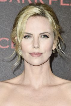 Charlize Theron shoes us how to wear the perfect cat-eye: