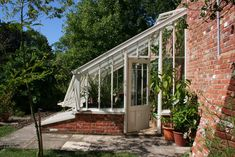 A pretty little mono-pitch lean to greenhouse - really good growing height on your back wall.