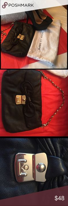 Marc by Marc Jacobs clutches Very nice soft soft leather, black  and gold cloths big as a purse , very very good condition , not tear , not stain either!!!! Just simply and elegant!!! ♣️♠️♣️♠️♣️♠️♣️♦️♣️♠️♦️ Marc by Marc Jacobs Bags Clutches & Wristlets