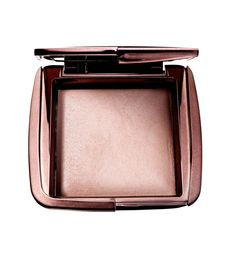 """Hourglass Ambient Lighting Powder, $45; sephora.com  This pressed powder contains tiny light-reflecting particles to blur imperfections, but the overall effect is just better skin. """"It gave my skin a lovely, radiant finish without looking shimmery,"""" said Reiss-Andersen.   - Redbook.com"""