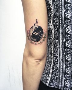 Pin for Later: 20 Globe Tattoos For Nomads With a Passion For Travel