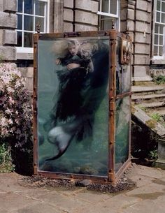 Mermaid inside a glass water tank art