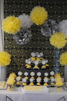 yellow and gray baby shower   (Yellow and silver pom poms together....ehh)