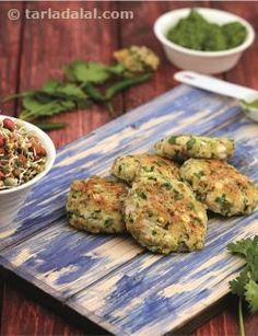 Main highlight of this recipe is use of chana dal, masoor dal and mixed sprouts. These are considered to be high in protein, but addition of Paneer improves the quality of the protein.  Also use of pulses makes this recipe high in fibre and iron….Serve it immediately with lovely green chutney and see how these tikkis disappear in a few minutes