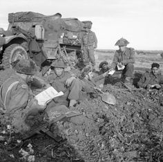Half-track and troops of 8th Battalion, The Rifle Brigade, 11th Armoured Division, during Operation 'Epsom', 29 june 1944.