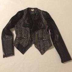 Vegan Leather & Tweed Jacket Motorcyle style vegan leather & tweed jacket.  The brand is Love Riche, purchased from a local boutique.  It has never been worn except to try on.  2 zippers on the front of jacket made to look like pockets, and each sleeve has a functioning zipper on the side.  Hits at natural waist for fit.   No trades or outside transactions, price is firm! Jackets & Coats