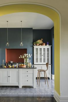 Top Kitchen Paint Color Ideas For The Heart Of Your Home TAG: Kitchen paint colors, Painting kitchen cabinets ideas, Kitchen color ideas Yellow Kitchen Decor, Home Decor Kitchen, Kitchen Interior, New Kitchen, Home Kitchens, Blue Walls Kitchen, Grey Yellow Kitchen, Quirky Kitchen, Eclectic Kitchen