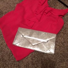 Victoria's Secret clutch Silver clutch with pink interior. *I'm also selling this tank in another listing. Would love to bundle! Victoria's Secret Bags Clutches & Wristlets