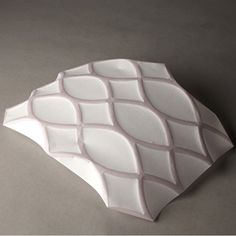 inkjet printer has been adapted by Ecole Cantonale d'art de Lausanne (ECAL) studentChristophe Guberan toprint patterns that contort pieces of paper into specific 3D forms.