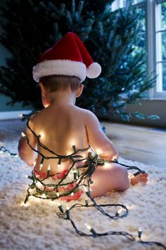 OMG This is SO CUTE!  Look out Christmas family & friends...you may just find a picture of my boys wearing nothing but lights on your Holiday Cards this year!!  ;)